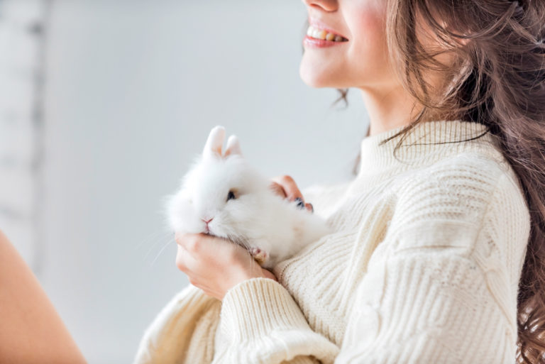 Women with white dwarf rabbit